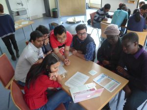 STUBE students in workshop discussing